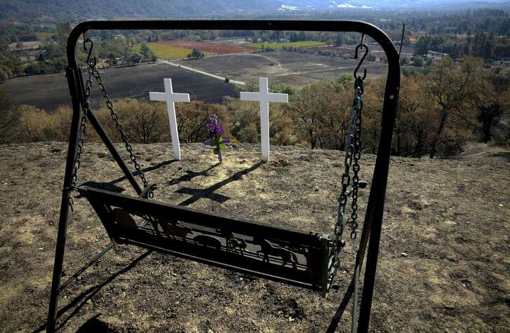 Crosses for victims Steve Stelter and Janet Costanzo who perished in Mendocino County's Redwood Valley Fire on Wednesday October 25, 2017. The Redwood Valley fire burned 36,523 acres, destroyed 545 structures and left eight people dead.