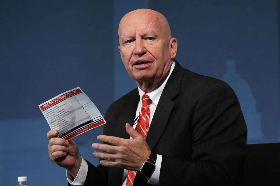 WASHINGTON, DC - NOVEMBER 03:  Chairman of House Ways and Means Committee Rep. Kevin Brady (R-TX) holds up a postcard size tax form during an event at the Newseum November 3, 2017 in Washington, DC. Rep. Brady participated in a Politico Playbook interview on congressional efforts on tax reform.  (Photo by Alex Wong/Getty Images) Photo: Alex Wong, Staff / 2017 Getty Images