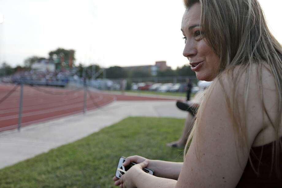 Trinity University fan Natasha Johnson answers questions from the media during the Trinity University and Austin College football game held Saturday Nov 4, 2017 at Trinity University. Photo: Edward A. Ornelas, Staff / San Antonio Express-News / © 2017 San Antonio Express-News