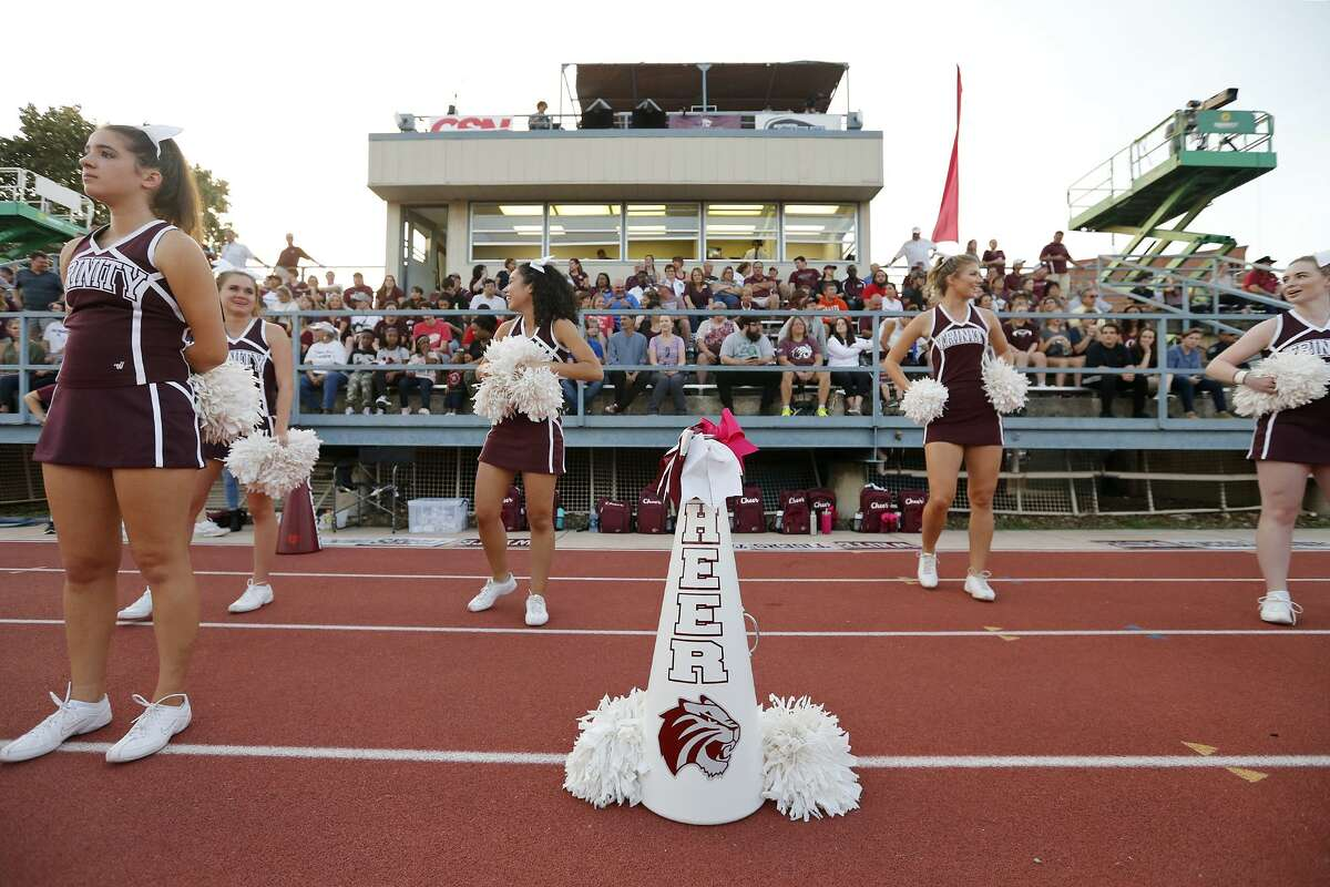 Trinity University Cheerleaders stand near a white megaphone for Trinity University student and cheerleader Cayley Mandadi, 19, during the Trinity University and Austin College football game held Saturday Nov 4, 2017 at Trinity University. Mandadi died Tuesday Oct. 31, 2017 at a hospital in Kyle.