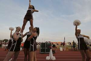 Trinity University Cheerleaders perform near a white megaphone for Trinity University student and cheerleader Cayley Mandadi, 19, during the Trinity University and Austin College football game held Saturday Nov 4, 2017 at Trinity University. Mandadi died Tuesday Oct. 31, 2017 at a hospital in Kyle.