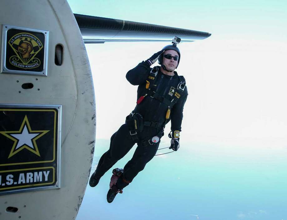 Sgt. Dusty Gebhardt, a member of the Army Golden Knights Parachute Team, jumps above the Kemah Boardwalk on Saturday during the Salute to Military Service and First Responders weekend. The event brought 86 veterans and their families to Kemah for the weekend. Photo: Yi-Chin Lee, Houston Chronicle / © 2017  Houston Chronicle