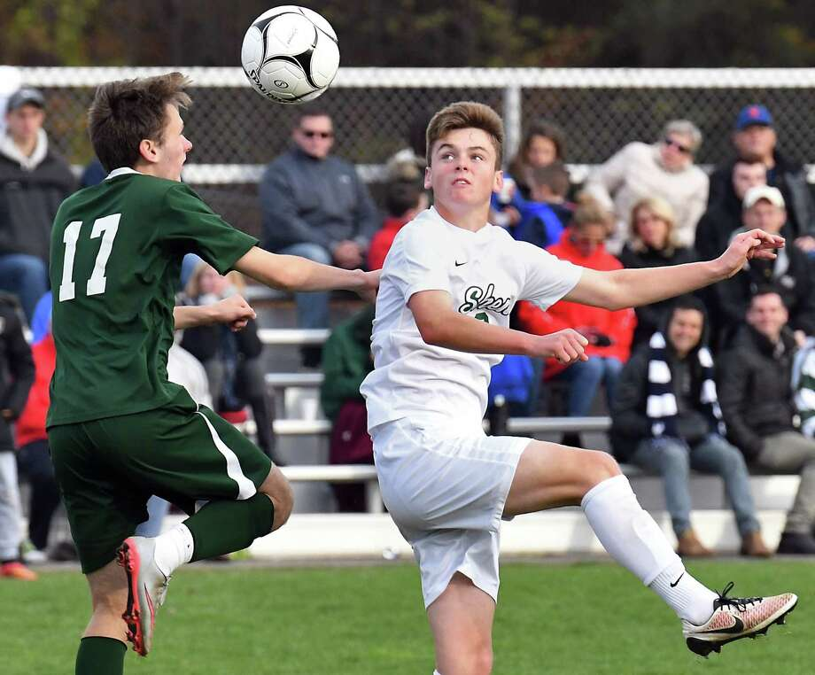 Fayetteville Manlius' #17 Nathan Donella, left, and Shen's #2 Jim Alexander during Saturday's regional match Nov. 4, 2017 in Colonie, NY.  (John Carl D'Annibale / Times Union) Photo: John Carl D'Annibale / 20042041A
