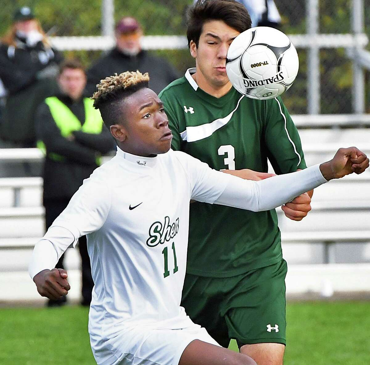 Shen's #11 Jaylin Sykes beats Fayetteville Manlius' #3 Luke D'Amato to the ball during Saturday's regional match Nov. 4, 2017 in Colonie, NY. (John Carl D'Annibale / Times Union)