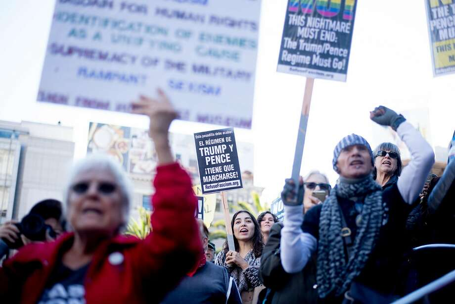Alexis Manzanilla (center) joins protesters in Union Square during a march against President Trump. Photo: Noah Berger, Special To The Chronicle