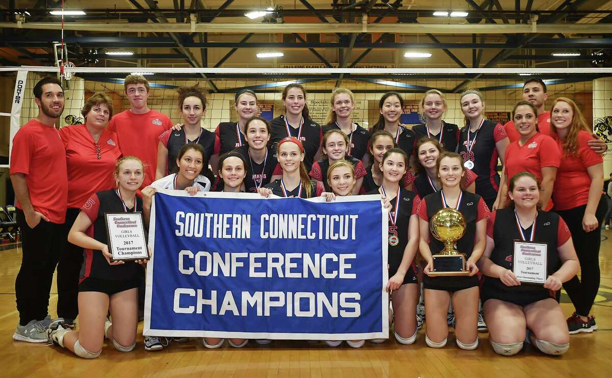 Cheshire players pose with the SCC championships banner after Saturday's win over Guilford.