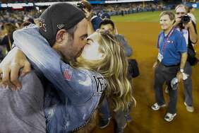 Houston Astros starting pitcher Justin Verlander (35) kisses Kate Upton after winning Game 7 of the World Series at Dodger Stadium on Wednesday, Nov. 1, 2017, in Los Angeles. ( Karen Warren / Houston Chronicle )