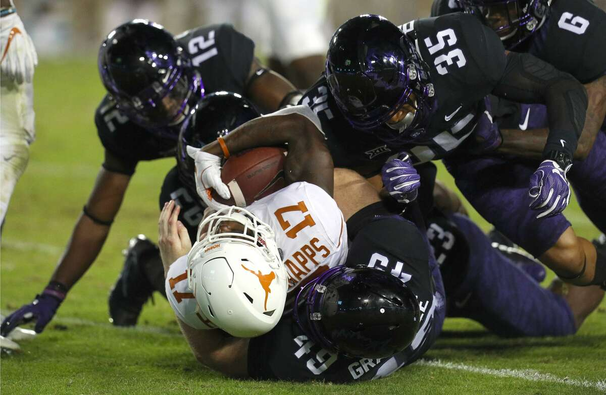 FORT WORTH, TX - NOVEMBER 04: Reggie Hemphill-Mapps (17) of the Texas Longhorns is tackled on the punt return by Lucas Gravelle (49) of the TCU Horned Frogs and Sammy Douglas (35) of the TCU Horned Frogs at Amon G. Carter Stadium on November 4, 2017 in Fort Worth, Texas. (Photo by Richard W. Rodriguez/Getty Images)