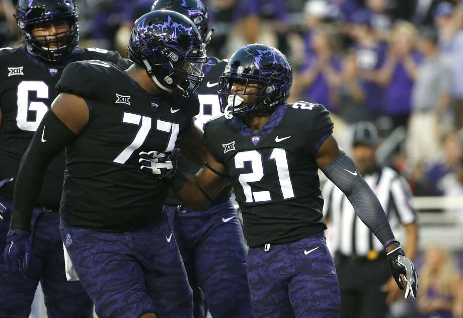 TCU's Lucas Niang (77) and running back Kyle Hicks (21) celebrate Hicks' touchdown during the first half of an NCAA college football game against Texas on Saturday, Nov. 4, 2017, in Fort Worth, Texas. (AP Photo/Ron Jenkins) Photo: Ron Jenkins/Associated Press