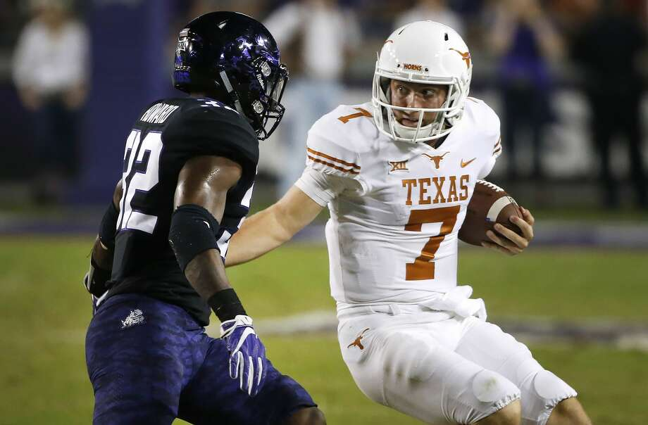 Texas quarterback Shane Buechele (7) is pursued by TCU linebacker Travin Howard (32) during the first half of an NCAA college football game Saturday, Nov. 4, 2017, in Fort Worth, Texas. (AP Photo/Ron Jenkins) Photo: Ron Jenkins/Associated Press