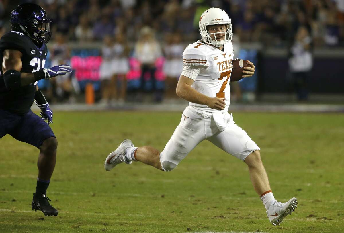 Texas quarterback Shane Buechele (7) is pursued by TCU linebacker Travin Howard (32) during the first half of an NCAA college football game Saturday, Nov. 4, 2017, in Fort Worth, Texas. (AP Photo/Ron Jenkins)