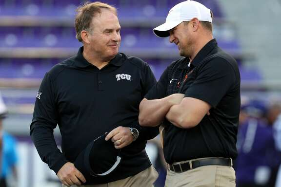 FORT WORTH, TX - NOVEMBER 04:  Head coach Gary Patterson of the TCU Horned Frogs visits with head coach Tom Herman of the Texas Longhorns before the game at Amon G. Carter Stadium on November 4, 2017 in Fort Worth, Texas.  (Photo by Richard W. Rodriguez/Getty Images)