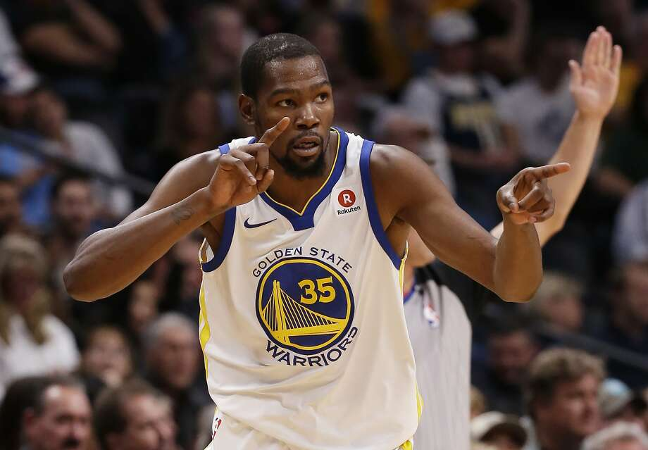 Golden State Warriors forward Kevin Durant celebrates after hitting a three-point basket against the Denver Nuggets during the third quarter of an NBA basketball game Saturday, Nov. 4, 2017, in Denver. (Photo by Jack Dempsey) Photo: Jack Dempsey, Associated Press