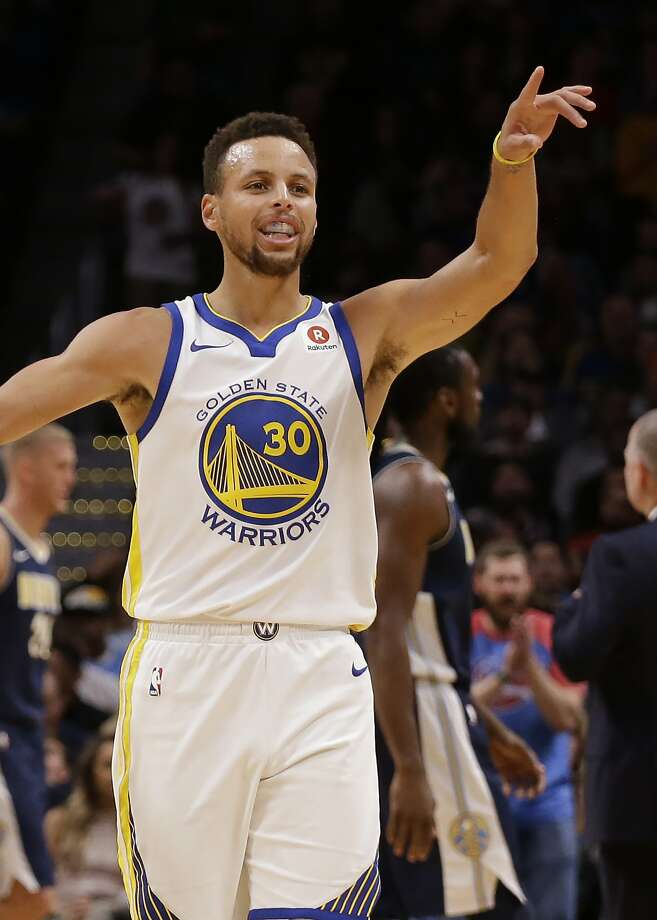 Golden State Warriors guard Stephen Curry celebrates his three-point basket against the Denver Nuggets during the third quarter of an NBA basketball game Saturday, Nov. 4, 2017, in Denver. Photo: Jack Dempsey, Associated Press