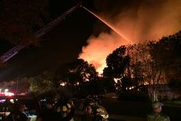 Firefighter battle a fire that destroyed the club house at Tapatio Springs Resort Saturday, Nov. 4, 2017.