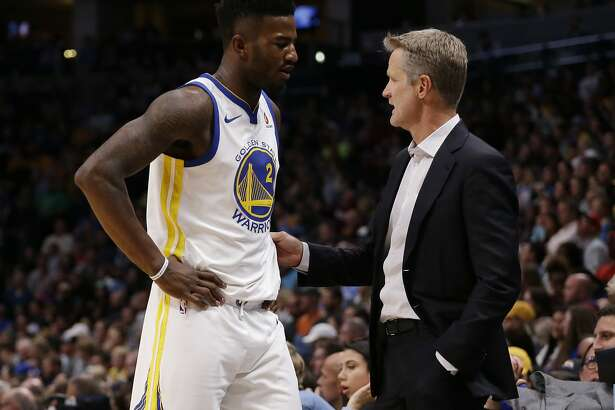 Golden State Warriors forward Jordan Bell (2) talks with head coach Steve Kerr during the second quarter of an NBA basketball game against the Denver Nuggets Saturday, Nov. 4, 2017, in Denver. (Photo by Jack Dempsey)