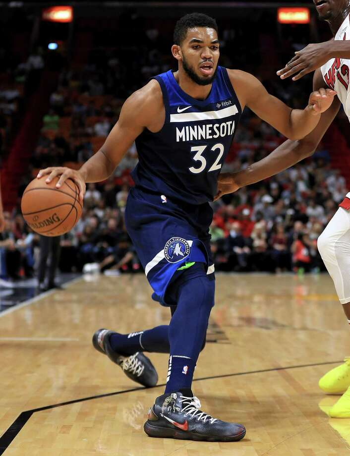 MIAMI, FL - OCTOBER 30:  Karl-Anthony Towns #32 of the Minnesota Timberwolves drives to the basket during a game against the Miami Heat at American Airlines Arena on October 30, 2017 in Miami, Florida. NOTE TO USER: User expressly acknowledges and agrees that, by downloading and or using this photograph, User is consenting to the terms and conditions of the Getty Images License Agreement.  (Photo by Mike Ehrmann/Getty Images) ORG XMIT: 775026741 Photo: Mike Ehrmann / 2017 Getty Images