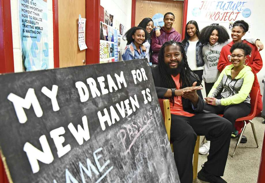 """New Haven,  Connecticut - Friday, November 3, 2017:   Frank E. Brady, the """"Dream"""" director of the Future Project at Wilbur Cross High School, front left, is an educator working with students and inspiring them to build projects based on their passions and dreams while empowering them to take leadership roles and to be catalysts for change in their communities. With Brady are some of the students who are part of the Future Project Leadership team at Wilbur Cross High School, from left to right rear: Kayla Lyas, Myanna Mallory, Ja'syn Jones, Janaya Edwards, Carielys Rosario, Jahlil Jefferies, and Valencia Harris. Photo: Peter Hvizdak / Hearst Connecticut Media / New Haven Register"""