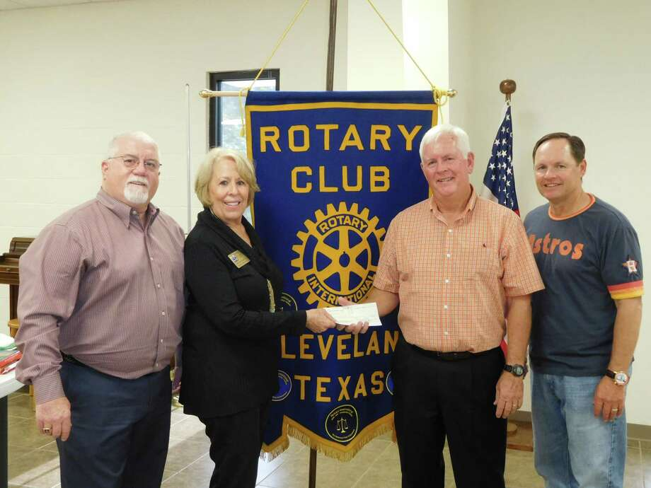 Cleveland Rotary Club makes a water well donation during the Nov. 1 meeting. Pictured making the donation are Rotarian and new Paul Harris Fellow Kevin Weldon; Rotarian and Assistant District 5910 Governor Ernestine Belt; speaker and Huntsville Rotarian David Standlee; and Rotary President Scott Lambert. Photo: Submitted