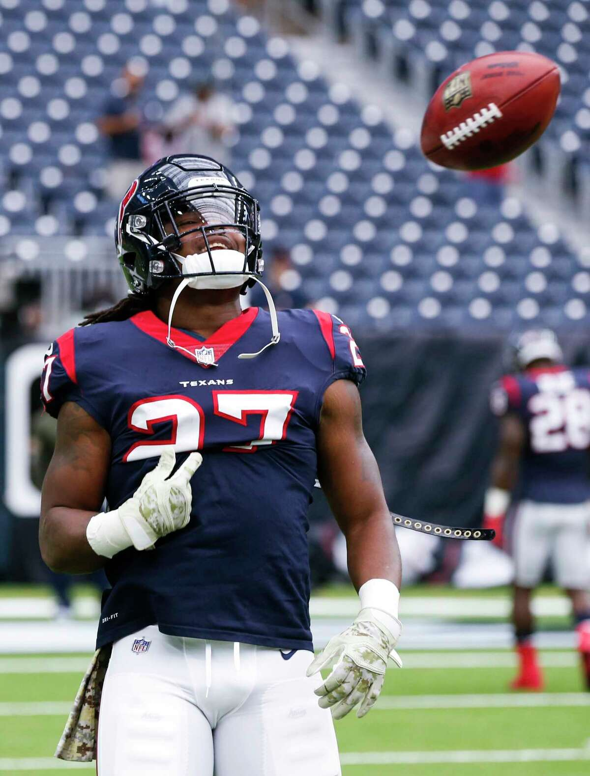 Houston Texans running back D'Onta Foreman (27) tosses a ball after catching a kick while warming up before an NFL football game at NRG Stadium on Sunday, Nov. 5, 2017, in Houston.