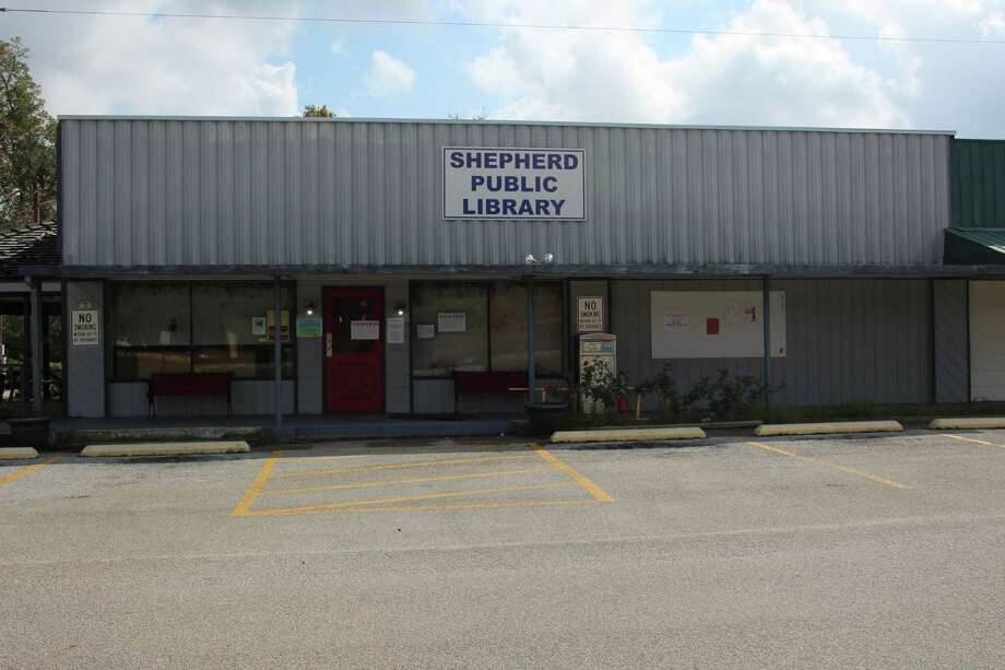The Shepherd Public Library is currently closed due to damage it received from Hurricane Harvey back in the month of August. The building is undergoing repairs and is receiving support from both inside and outside of Texas with a library from Shepherd, Mich., sending support through a $500 check, which the Shepherd Public Library received on Oct. 30. Photo: Jacob McAdams