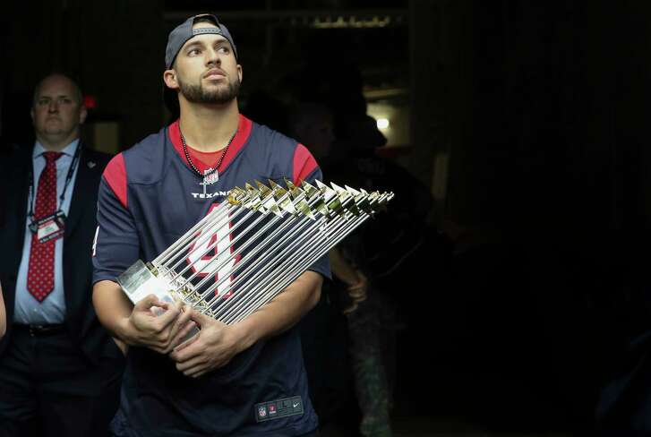 Houston Astros' George Springer bears the Wolrd Series Trophy and waiting in the tunnel to be recognized to the audience during the first quarter of an NFL football game between Houston Texans and Indianapolis Colts at NRG Stadium on Sunday, Nov. 5, 2017, in Houston.