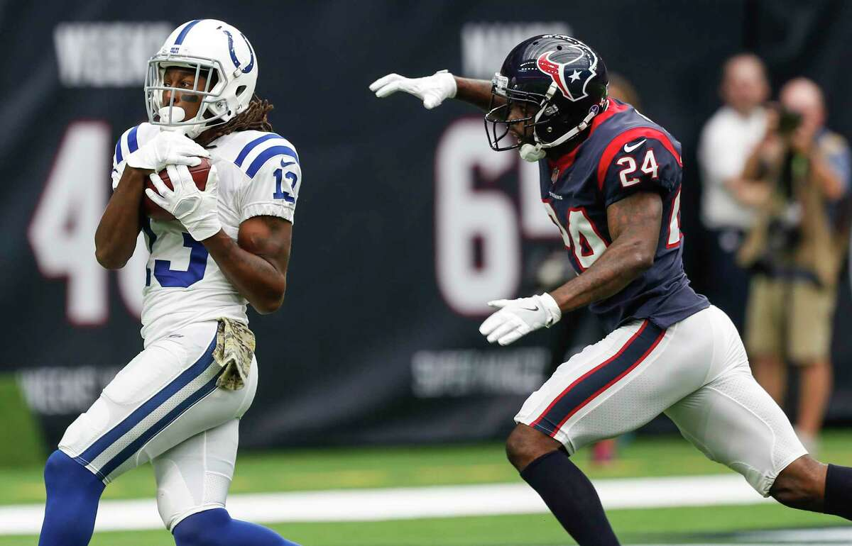 Indianapolis Colts wide receiver T.Y. Hilton (13) beats Houston Texans cornerback Johnathan Joseph (24) for a 45-yard touchdown reception during the first quarter of an NFL football game at NRG Stadium on Sunday, Nov. 5, 2017, in Houston.