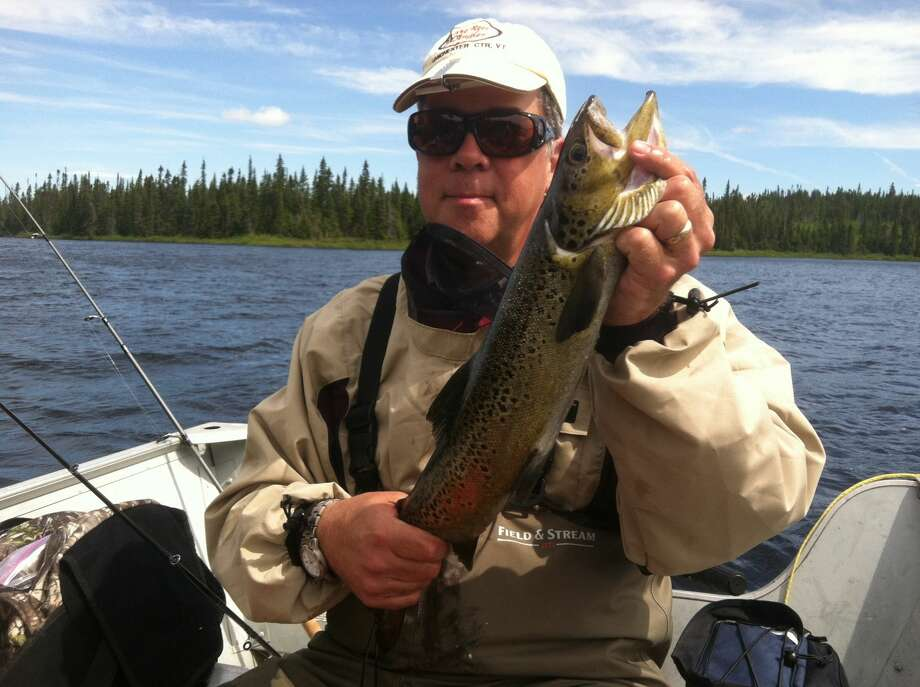 1. Fisherman: fly rod and spinning rod. Photo: Courtesy Of Jim Kambrich