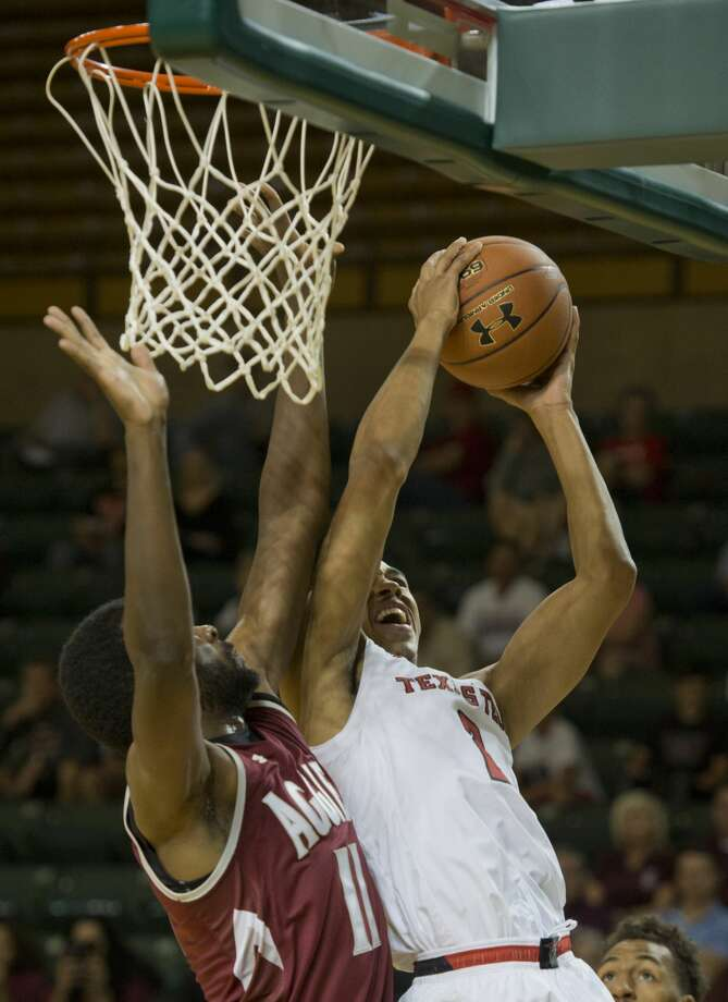 New Mexico State's Johnathon Wilkins defends as Texas Tech's Zhaire Smith goes to the basket 11/05/17 in a charity game at the MC Chaparral Center. Tim Fischer/Reporter-Telegram Photo: Tim Fischer/Midland Reporter-Telegram