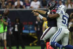 Houston Texans quarterback Tom Savage (3) passes the ball before he is tackled by Indianapolis Colts inside linebacker Jon Bostic (57) during the first quarter of an NFL football game at NRG Stadium on Sunday, Nov. 5, 2017, in Houston.