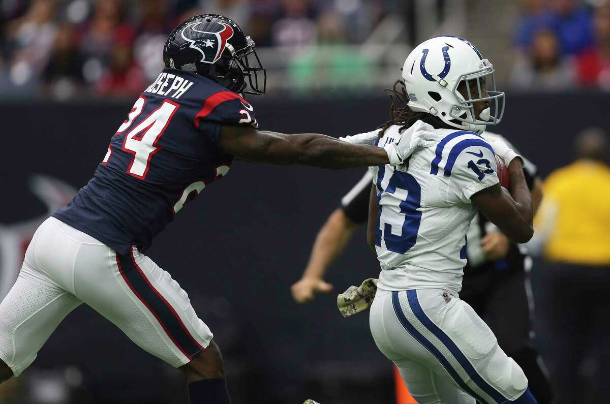 Houston Texans cornerback Johnathan Joseph (24) is not able to stop Indianapolis Colts wide receiver T.Y. Hilton (13) from catching a 45-yeard pass and scoring a touch down during the first quarter of an NFL football game at NRG Stadium on Sunday, Nov. 5, 2017, in Houston.