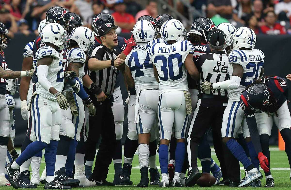 The referee tries to stop an altercation between Houston Texans and Indianapolis Colts players during the third quarter of an NFL football game at NRG Stadium on Sunday, Nov. 5, 2017, in Houston.