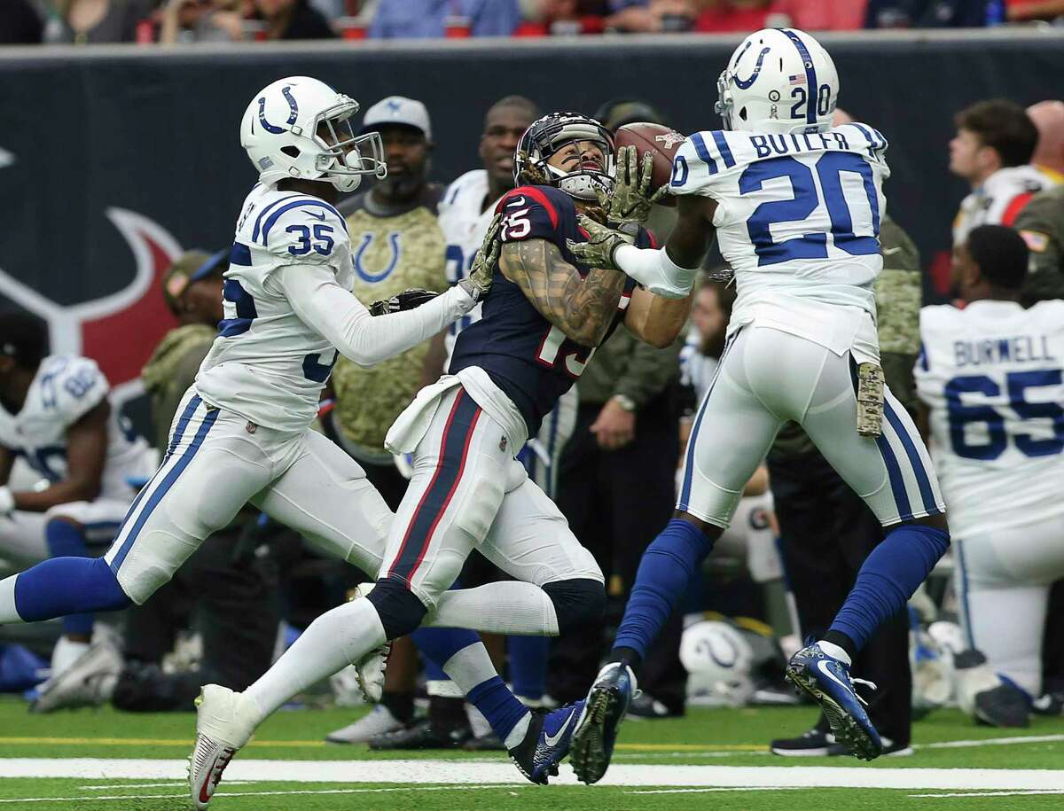 Houston Texans quarterback Tom Savage's pass to wide receiver Will Fuller (15) is incomplete while Indianapolis Colts players Pierre Desir (35) and Darius Butler (20) are defensing during the third quarter of an NFL football game at NRG Stadium on Sunday, Nov. 5, 2017, in Houston.