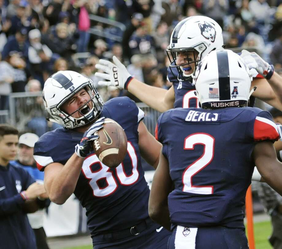 UConn senior tight end Tommy Myers (80) celebrates after scoring against USF on Saturday. Photo: Stephen Dunn / Associated Press / FR171426 AP