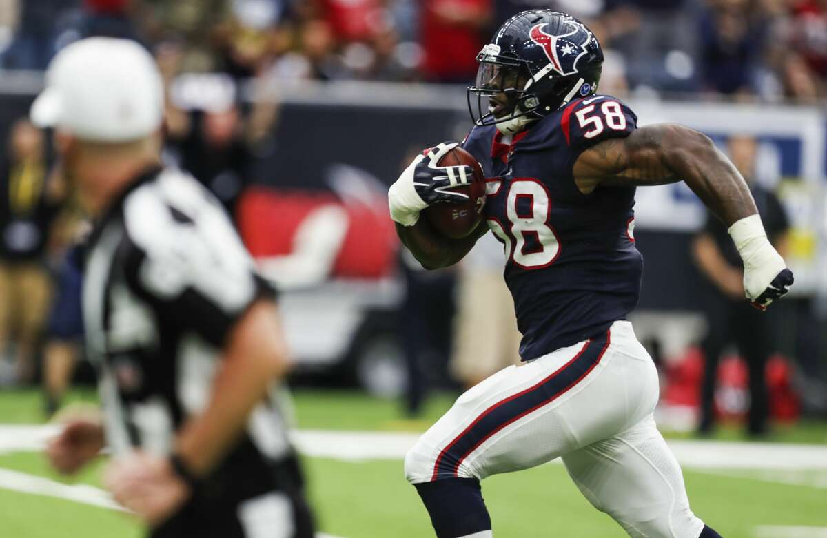 Houston Texans linebacker Lamarr Houston (58) returns a fumble by Indianapolis Colts quarterback Jacoby Brissett 34 yard for a touchdown during the second quarter of an NFL football game at NRG Stadium on Sunday, Nov. 5, 2017, in Houston. ( Brett Coomer / Houston Chronicle )
