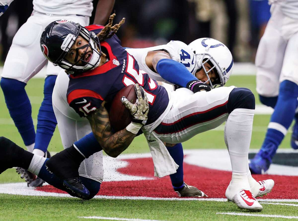 Houston Texans wide receiver Will Fuller (15) twists forward as he is hit by Indianapolis Colts strong safety Matthias Farley (41) for a first down during the second quarter of an NFL football game at NRG Stadium on Sunday, Nov. 5, 2017, in Houston.