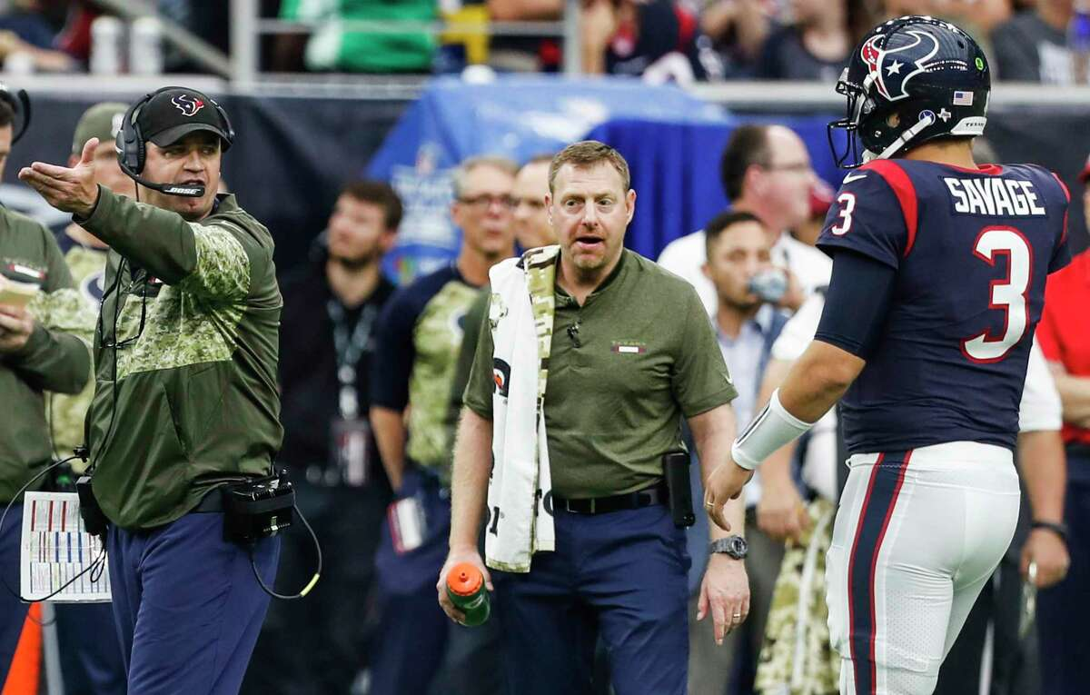 Houston Texans head coach Bill O'Brien talks to quarterback Tom Savage (3) during a time out in the third quarter of an NFL football game against the Indianapolis Colts at NRG Stadium on Sunday, Nov. 5, 2017, in Houston.