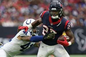 Houston Texans running back D'Onta Foreman (27) rushes the ball against Indianapolis Colts strong safety Matthias Farley (41) during the second half of the game at NRG Stadium Sunday, Nov. 5, 2017, in Houston. The Colts won 20-14.