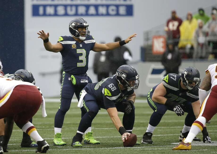Seattle Seahawks quarterback Russell Wilson (3) called to his team as he lines up behind center Justin Britt in the first half of an NFL football game against the Washington Redskins, Sunday, Nov. 5, 2017, in Seattle. (AP Photo/Elaine Thompson) Photo: Elaine Thompson/AP