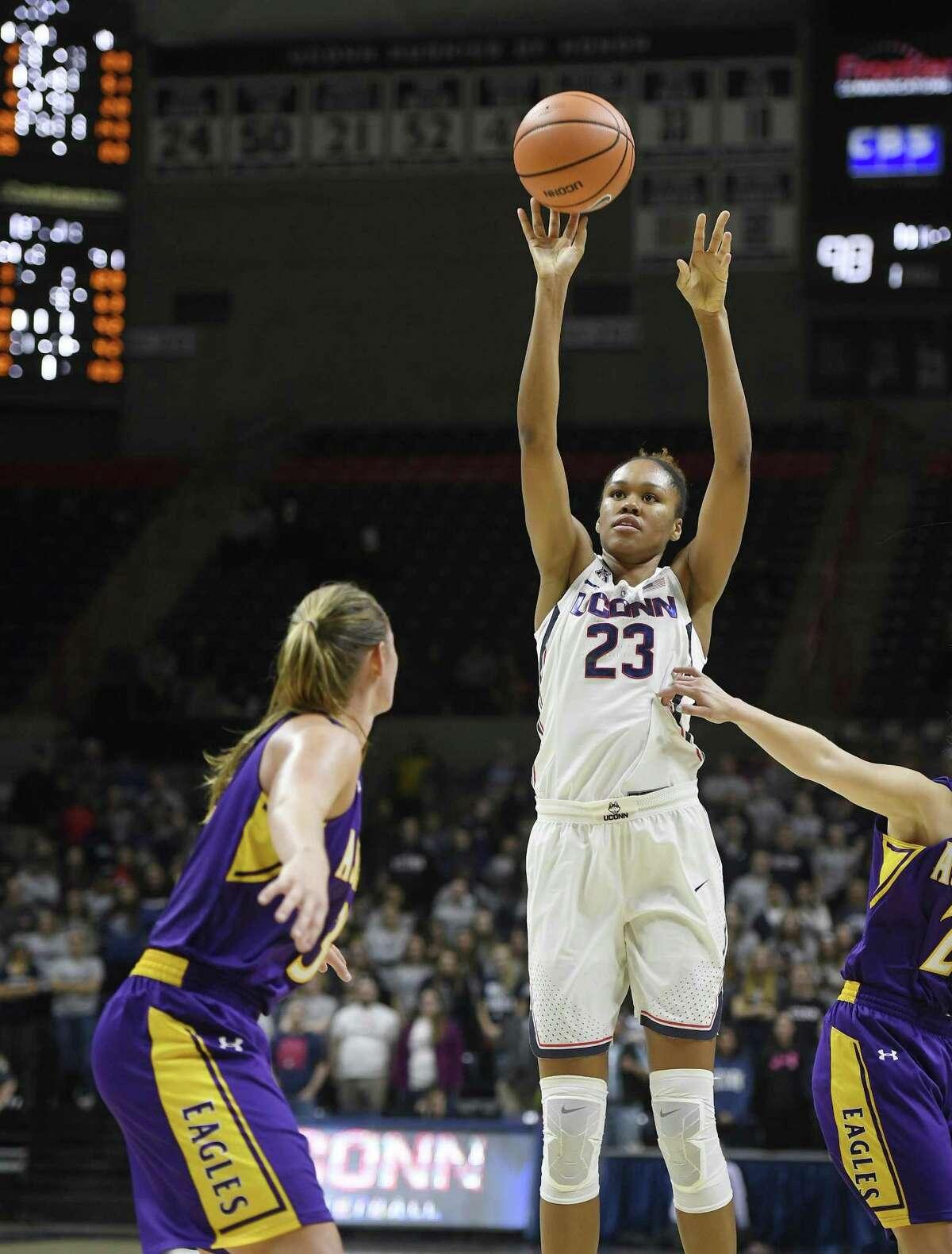 UConn's Azura Stevens (23) shoots in the second half Sunday.