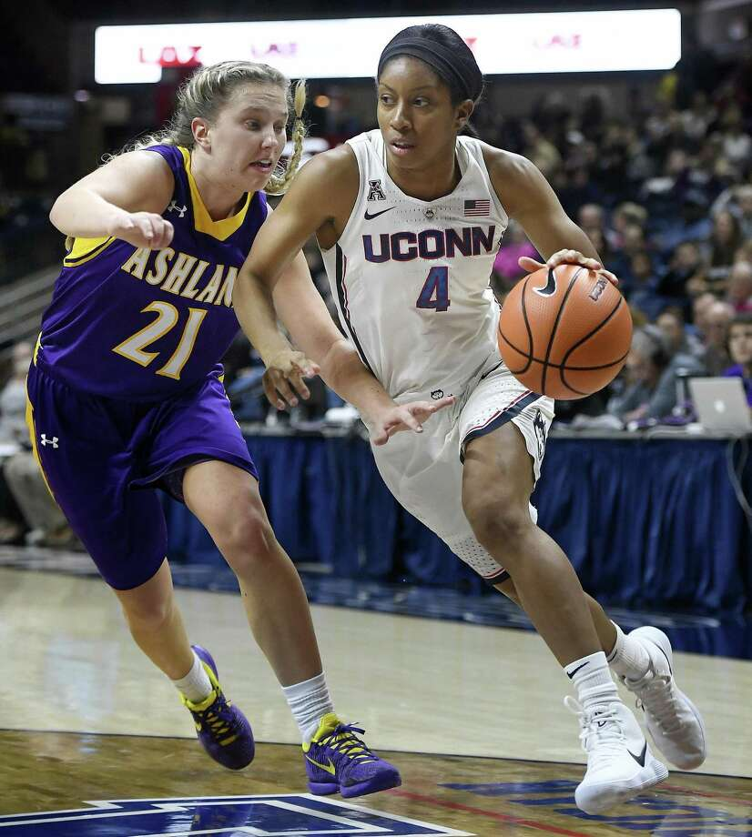 Connecticut's Mikayla Coombs (4) dribbles as Ashland's Jodi Johnson (21) defends in the second half of an NCAA college exhibition basketball game, Sunday, Nov. 5, 2017, in Storrs, Conn. (AP Photo/Jessica Hill) Photo: Jessica Hill / Associated Press / AP2017