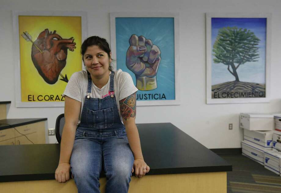 Cristina Sosa Noriega painted three large Mexican Loteria panels installed recently at Kipp University Prep High School that represent the school's core principles and her vast art work of San Antonio's Latino culture. The students chose to have the school's three character traits, heart, growth and justice portrayed in a culturally relevant way on campus. (Kin Man Hui/San Antonio Express-News) Photo: Kin Man Hui, Staff / San Antonio Express-News / ©2017 San Antonio Express-News