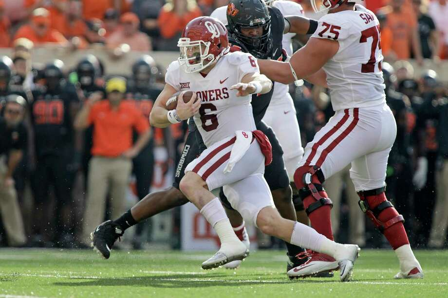 STILLWATER, OK - NOVEMBER 04: Quarterback Baker Mayfield #6 of the Oklahoma Sooners scrambles out of the pocket against the Oklahoma State Cowboys at Boone Pickens Stadium on November 4, 2017 in Stillwater, Oklahoma. Oklahoma defeated Oklahoma State 62-52.  (Photo by Brett Deering/Getty Images) Photo: Brett Deering, Stringer / 2017 Getty Images