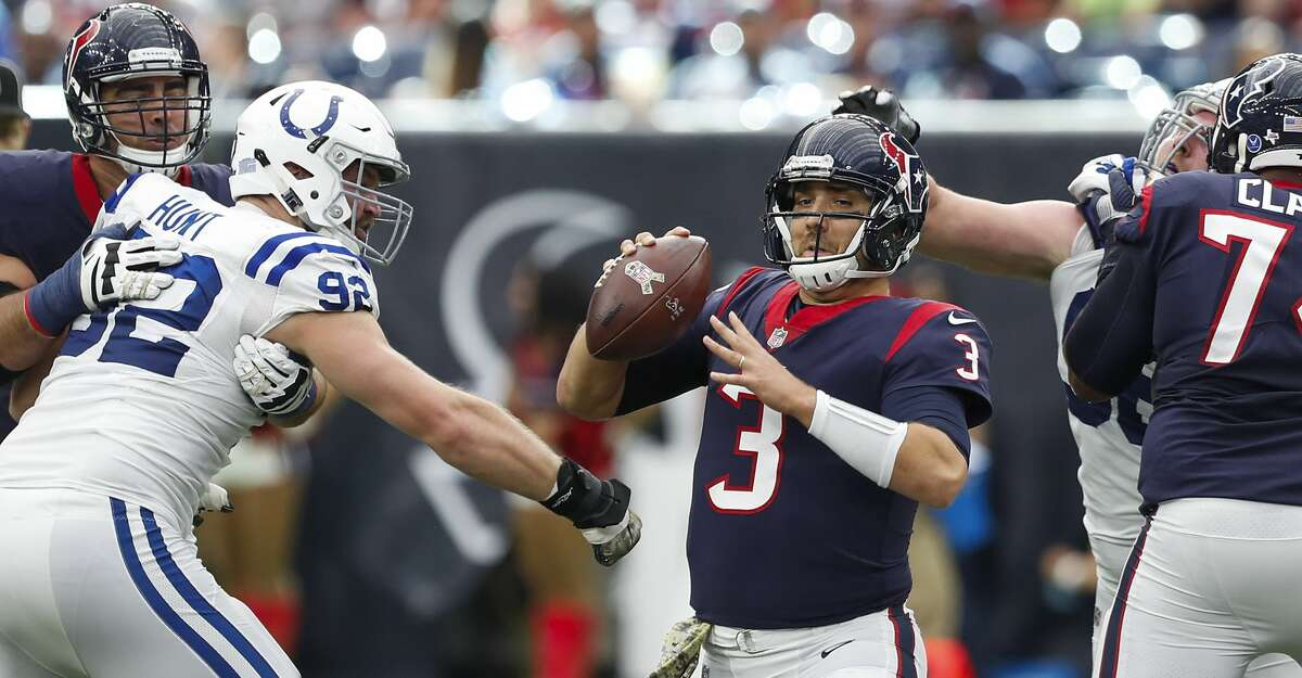 Houston Texans quarterback Tom Savage (3) is forced out of the pocket by Indianapolis Colts defensive end Margus Hunt (92) during the fourth quarter of an NFL football game at NRG Stadium on Sunday, Nov. 5, 2017, in Houston. ( Brett Coomer / Houston Chronicle )