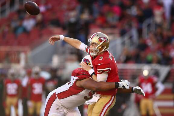 SANTA CLARA, CA - NOVEMBER 05:  C.J. Beathard #3 of the San Francisco 49ers is hit as he throws by Corey Peters #98 of the Arizona Cardinals during their NFL game at Levi's Stadium on November 5, 2017 in Santa Clara, California.  (Photo by Ezra Shaw/Getty Images)