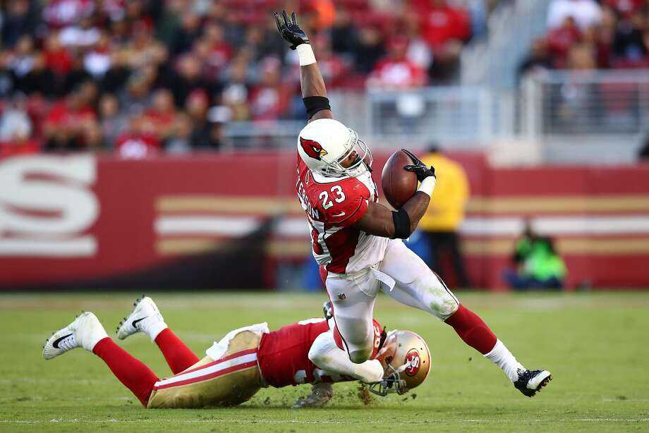 Adrian Peterson #23 of the Arizona Cardinals is tackled by Reuben Foster #56 of the San Francisco 49ers during their NFL game at Levi's Stadium on November 5, 2017 in Santa Clara, California. Photo: Ezra Shaw, Getty Images