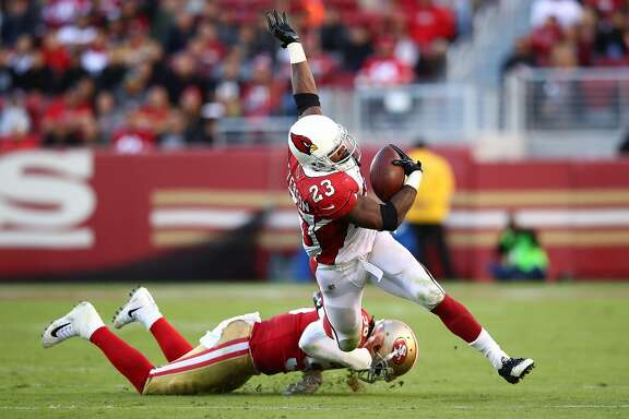 SANTA CLARA, CA - NOVEMBER 05:  Adrian Peterson #23 of the Arizona Cardinals is tackled by Reuben Foster #56 of the San Francisco 49ers during their NFL game at Levi's Stadium on November 5, 2017 in Santa Clara, California.  (Photo by Ezra Shaw/Getty Images)