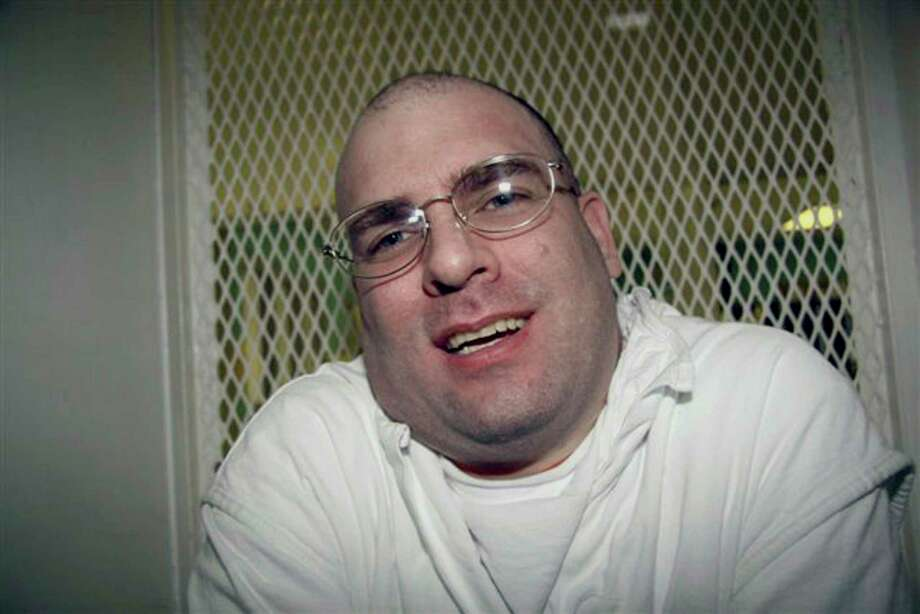 "FILE- In this Jan. 7, 2009, file photo, Texas death row inmate Larry Swearingen speaks from the interview cage at the death row facility in Livingston, Texas.  A judge on Wednesday, Oct. 18, 2017, halted the execution of Swearingen, known as the Houston area's ""Tourniquet Killer,"" so authorities can investigate an alleged scheme in which the inmate says a fellow death row prisoner asked him to confess to another killing. (AP Photo/Mike Graczyk, File) Photo: Mike Graczyk, STF / AP2009"