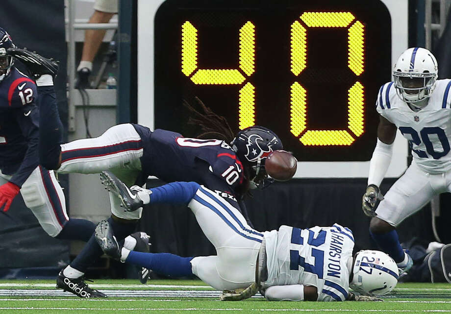 With at least two Colts defenders covering Texans wide receiver DeAndre Hopkins (10), a pass from quarterback Tom Savage falls incomplete in the waning moments of Sunday's loss. Photo: Yi-Chin Lee, Staff / © 2017 Houston Chronicle