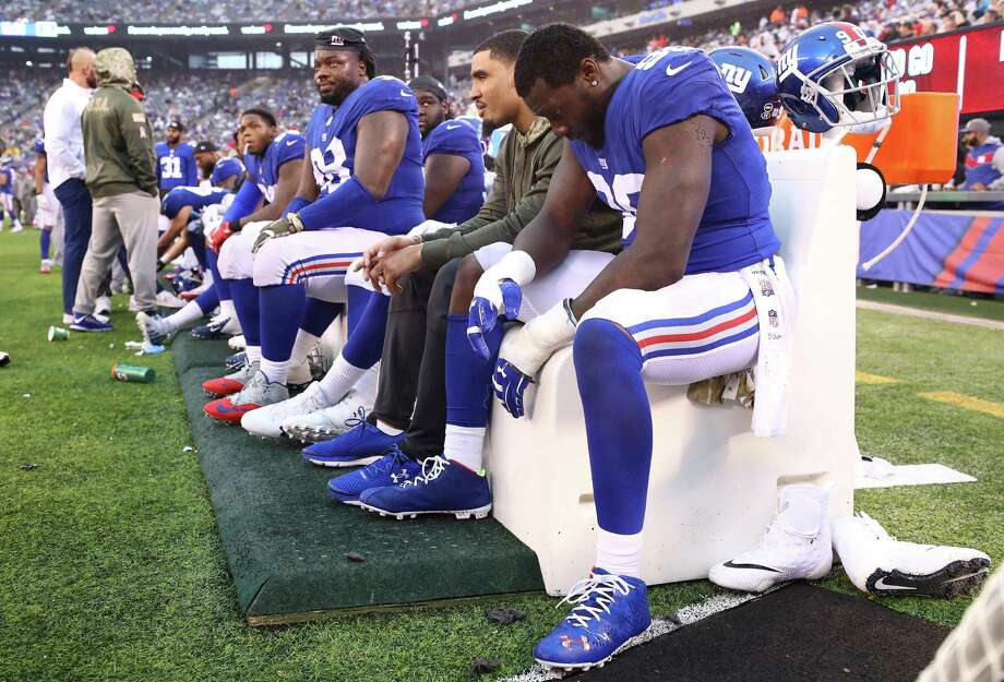 Jason Pierre-Paul (90) and Damon Harrison (98) of the New York Giants sit on the bench during their 51-17 loss to the L.A. Rams at MetLife Stadium on Sunday in East Rutherford, N.J. Photo: Al Bello / Getty Images / 2017 Getty Images